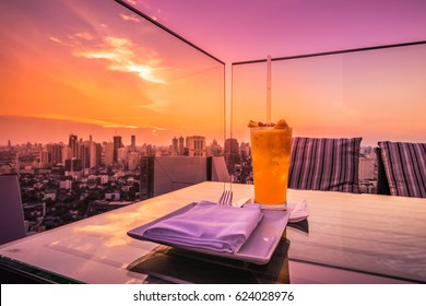 abstract yellow cocktail on rooftop bar and cityscape view with twilight sunset time - can use to display or montage on product