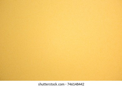 Abstract yellow gold Texture. Granular Grunge Paper Background With Copy Space. Decorative plaster surface wall
