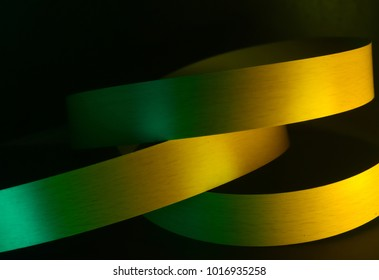 Abstract yellow ribbon object background photograph