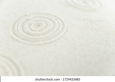 Abstract Zen drawing on white sand. Concept of harmony, balance and meditation, spa, massage, relax. Zen garden.