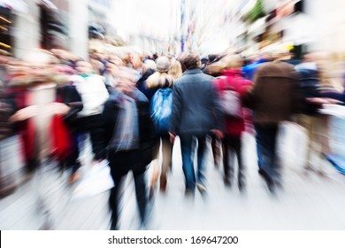 abstract zoom picture of a walking crowd in the shopping street of a city