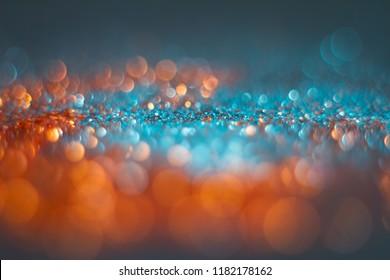 Abstraction orange bokeh on a blue background. Defocused.