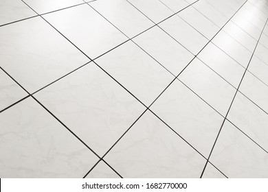 abstraction of perpendicular lines, squares in perspective.  from the tiled floor.