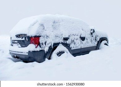 Abstraction, place for insertion. Car littered with snow. Snowfall covered the car with snow.