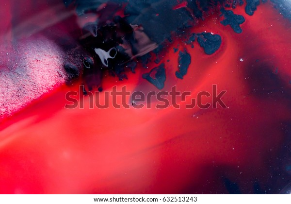 Abstraction of red and black paint watercolor texture background.