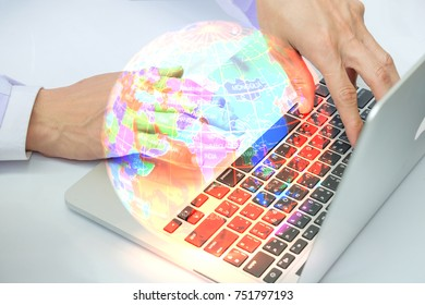Abstract,Man typing on laptop on world background.