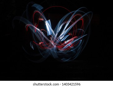 abstrak drawing with red and white colour of flashlight on dark background