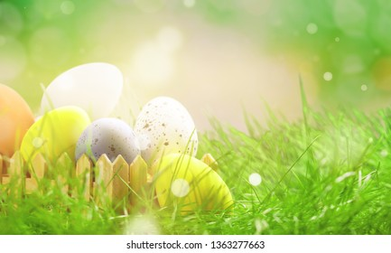 Abstrakt green spring scenery with easter eggs and bright bokeh for a background          - Image