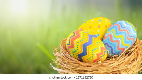 Abstrakt green spring scenery with easter eggs and bright bokeh for a background