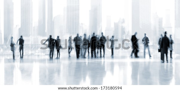 abstrakt image of people in the lobby of a modern business center with a blurred background and blue tonality