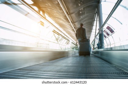 abstrakt image of people in speed on a skywalk