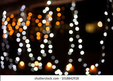 Abstrast photo of blurred, bright lights against a dark background