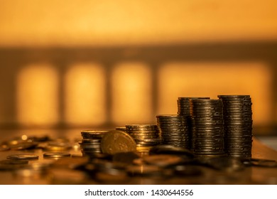 Abtract background of growth money in the golden tone, professional investment and high return profit, business and finance concept.