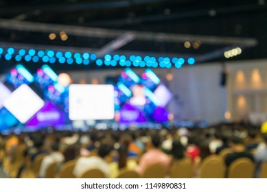Abtract blur people in conference seminar presentation at conference exhibition hall background