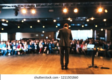 Abtract blur people and speaker in seminar lecture presentation at conference exhibition hall background