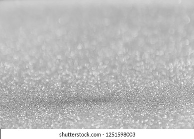 abtract light blur Bokeh for luxury background. Sparkling Gray light for Christmas celebrations. Elegant design Glowing shiny white giltter For greeting cards.