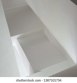 Abtract Perspective of an Underside of a  White Plastered Finish Concrete Staircase