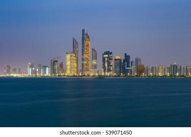 Abu Dhabi City skyline in night time panorama