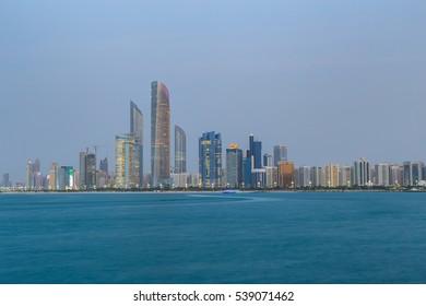 Abu Dhabi City skyline in sunset panorama