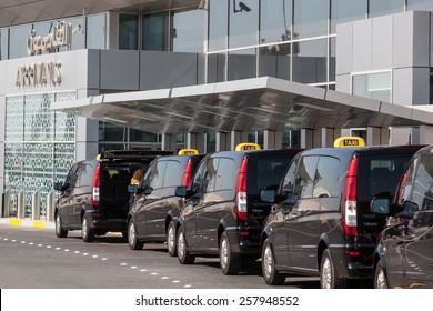 ABU DHABI - DEC 19: Taxis at the Abu Dhabi International Airport. December 19, 2014 in Abu Dhabi, United Arab Emirates