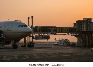 Abu Dhabi . November 2012. Early morning. Passengers leaving an airplane using a jet bridge