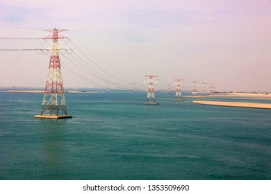 Abu Dhabi sea view, UAE. Electricity transmissions.