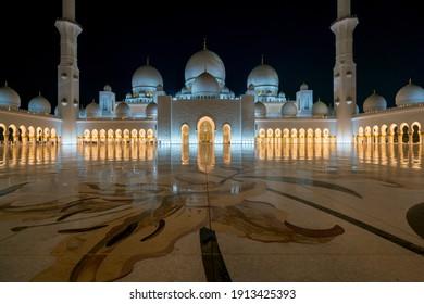 Abu Dhabi, UAE - 11.03.2017: Night at the courtyard of Grand Mosque of Abu Dhabi. Sheikh Zayed Grand Mosque