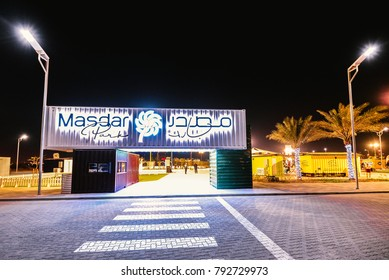 Abu Dhabi, UAE - 2017 - Entrance of Masdar Park, an outdoor Playground & dinning destination housed inside recycled shipping containers powered by solar panels,  all park is themed on sustainability