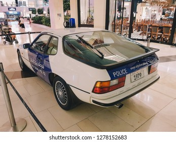 Abu Dhabi, UAE - 2018 -A White and blue 1979 Vintage Porsche Abu Dhabi New Police Patrol car in display in YAS mall after unveiled by police as   rebrand and relaunch as a force, Abudhabi, UAE.