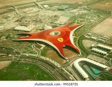 ABU DHABI, UAE -  APRIL 07: Ferrari World Park is the largest indoor amusement park in the world. The roof has a total surface area of 200,000 m2.  Abu Dhabi on April 07, 2012. Bird's eye view