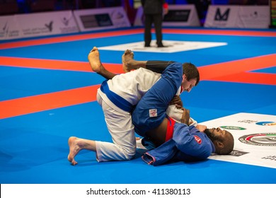 ABU DHABI, UAE - APRIL 19, 2016: ABU DHABI WORLD PROFESSIONAL JIU-JITSU CHAMPIONSHIP 2016 in the IPIC ARENA. Fighters on the mat.