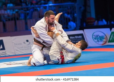 ABU DHABI, UAE - APRIL 19, 2016: ABU DHABI WORLD PROFESSIONAL JIU-JITSU CHAMPIONSHIP 2016 in the IPIC ARENA. Fighters with brown belts on the mat.