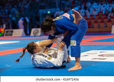ABU DHABI, UAE - APRIL 19, 2016: ABU DHABI WORLD PROFESSIONAL JIU-JITSU CHAMPIONSHIP 2016 in the IPIC ARENA. Female fighters in the parterre.