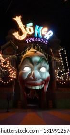 Abu Dhabi, UAE- Circa 2019, Warner Brothers Theme Park, Yas Island, Gotham City at Night, The Joker Funhouse
