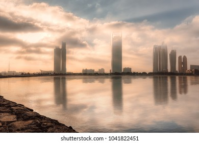 Abu Dhabi, UAE cityscape and skyline with reflection on the water