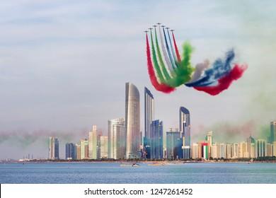 ABU DHABI, UAE - DECEMBER 02, 2018: Al Fursan aerobatic team doing stunts in the sky in Abu Dhabi, UAE