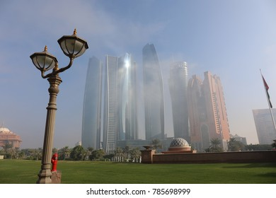 ABU DHABI, UAE - December 22, 2017 : Skyscraper of Abu Dhabi covered in cloud