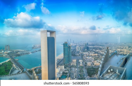 ABU DHABI, UAE - DECEMBER 8, 2016: Panoramic sunset city skyline. Abu Dhabi attracts 10 million people annually.