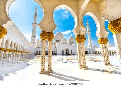 ABU DHABI, UAE - FEB 08: Inner court yard and minaret of the largest mosque in the United Arab Emirates and the eighth largest mosque in the world. Abu Dhabi, UAE - February 08, 2014