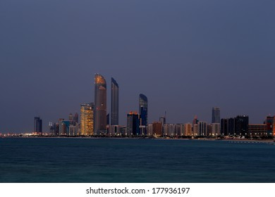 ABU DHABI, UAE - FEB 7: A skyline view of the Corniche Road taken at dusk on Feb 7, 2014 in Abu Dhabi, UAE.