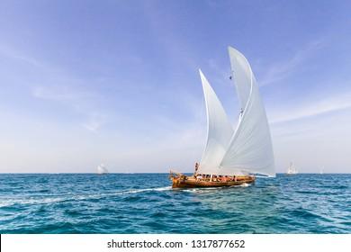 ABU DHABI, UAE - FEBRUARY 10, 2018: Sailing dhows race back to Abu Dhabi at 60 Feet Dhow Sailing Race.