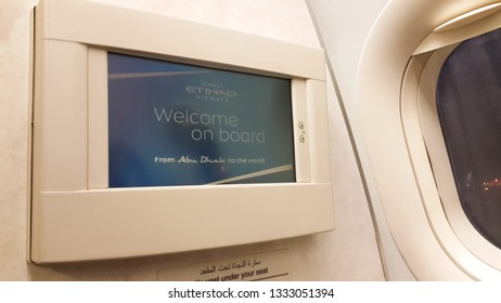 Abu Dhabi, UAE - February 17, 2019: Inside Etihad Airways Airbus A320 - seen is the on-flight entertainment screen of the first row of Economy Class
