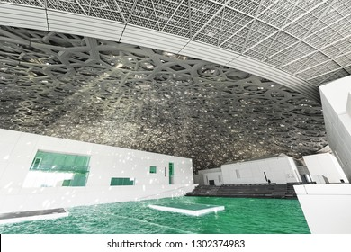 ABU DHABI, UAE - JAN 22, 2019:  The Louvre museum Abu Dhabi with its extraordinary roof pouring sunlight indoors.