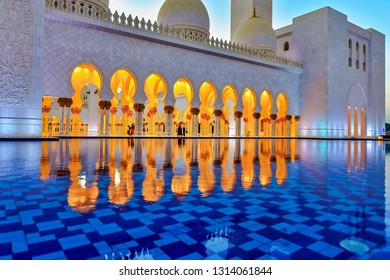 ABU DHABI, UAE - JAN 22, 2019: Reflections of the golden walkway inside the Sheikh Zayed Mosque or the grand Mosque during evening.