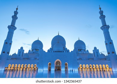 ABU DHABI, UAE - JAN 22, 2019: Courtyard inside the Sheikh Zayed Mosque or the grand Mosque illuminated during evening.