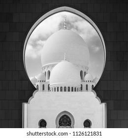 Abu Dhabi, UAE, Januaey 30, 2016: View of main dome of the Sheikh Zayed Grand Mosque framed by an arch. Abu Dhabi, UAE