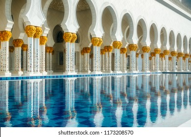 ABU DHABI, UAE - MARCH 08,2014 : Architecture and interiors with a pool of the Sheikh Zayed Grand mosque.