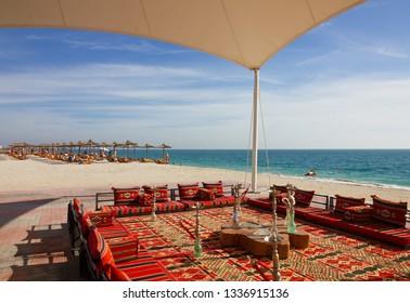 Abu Dhabi, UAE - March 12, 2019: Beach on Sir Bani Yas island.  Abu Dhabi Emirate. Hookah cafe