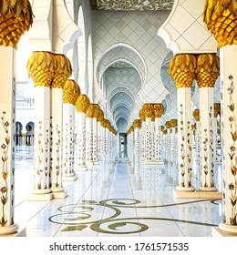 Abu Dhabi, UAE - March, 2020: White marble columns and arcades of the world famous Sheikh zayed grand mosque