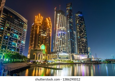 Abu Dhabi, UAE - March 29. 2019. Complex of skyscrapers - The Etihad Towers and Bab Al Qasr Hotel with night illumination from sea